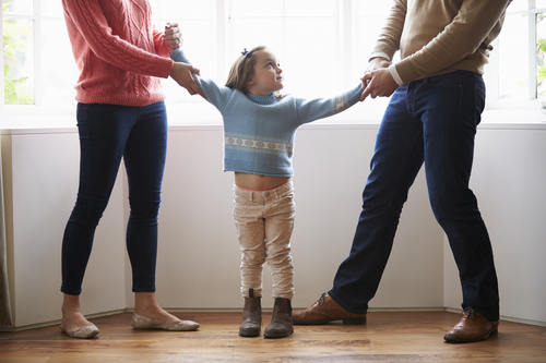 Two Parents Fighting Over Child In Divorce Concept